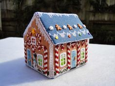 Wendy's quilts and more: My Gingerbread Village.  I can't needlepoint - why can't I find this house ready-made to purchase for my collection?  so pretty.