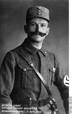 Urlich Graf (1878-1950) was one of the earliest Nazis and Hitler's personal bodyguard from 1920 to 1925. During the abortive Beer Hall putsch in 1923, Graf saved Hitler's life when he threw himself in front of the the Leader and took a bullet aimed at Hitler. On 20 April 1943, Hitler's birthday, he became an SS Brigadeführer. After the war he was sentenced to 5 year's hard labor but died soon after of natural causes.
