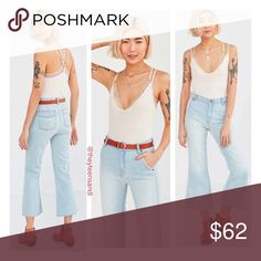 "Urban Outfitters High Waist Crop Flare Mom Jeans BDG Penny Crop Flare Jean in Vintage Light Blue Denim. BDG's high-rise Penny kick flare jeans in a flower child-inspired light blue wash. Fitted through the waist with 4 pockets detailed with piping and a button-up zipper fly. Finished with cropped bell bottoms for a modern-retro silhouette we can't get enough of. Purchased from Urban Outfitters. 100% Cotton. Machine wash. Model is 5'10"" and wearing size 26. Measurements taken from size…"