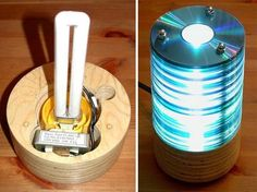 We've got spools of CD-Rs we don't need any more or that went bad. Perhaps we should try and make our own desk lamp like this one that uses a 13W twin tube fluorescent bulb...