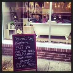 Bath and Beauty boutique window display - sidewalk chalkboard <3