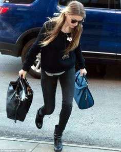 t-shirt + fitted sweater over + dark skinnies + boots + necklace + hair pulled back