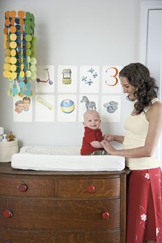 vintage dresser as changing table.  a lovely lark: Lovely Little Room: Colorful + Crafty