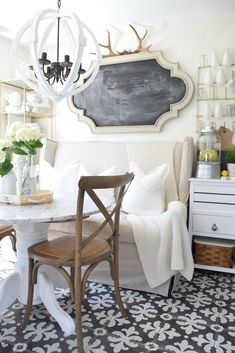 Summer Home Tour Kitchen Updates. Eat in kitchen with marble table and painted patterned tile.