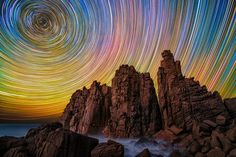 Australia-based photographer Lincoln Harrison captures stunning long exposure photographs of star trails in the night sky