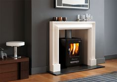 Wood burning stove, white fireplace, grey walls (maybe not so dark tho) New Living Room, Home And Living, Living Room Decor, Dining Room, White Fireplace, Stove Fireplace, White Mantel, Fireplace Ideas, Log Burning Stoves