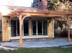 Attached Pergola - This patio pergola was designed to extend the inside living area to the outside. The overhead pergola structure creates a transition from indoors to outdoors. The main beams extend out from the house and are supported by an interesting connector assembly. A simple, but nicely resolved solution, to a common request. http://www.trellisstructures.com/pergolas/ap05-attached-pergola.html