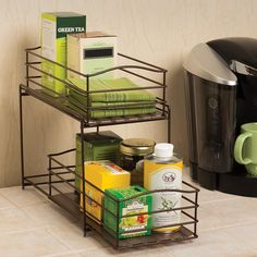 Keep all pantry items, kitchenware, small appliances and other cookware handy with the Rebrilliant 2-Tier Sliding Basket Kitchen Cabinet Organizer! Made in a sturdy iron construction, this double basket organizer is the perfect addition to any counter top or cabinet. Customize your space by using both baskets or simply detach and use the basket separately for more storage options. Each basket tall and includes two BPA free plastic shelf liners. With both baskets attached.
