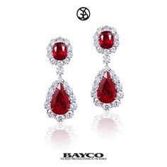 From The Magnificent Collection - A pair of ruby ear pendants each centered upon…