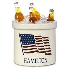 """American Heritage Ceramic Crock: Think of the endless ways you could put this item to great use around your home. From holding a plant in your entryway to kindling on the hearth, it can also sit on the deck to hold cold beers or on your kitchen counter full of utensils. This crock is 9.75"""" in diameter and 9"""" high. It can hold one line of personalization with up to fourteen 1"""" characters."""