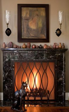 If the black marble mantel wasn't gorgeous enough, designer Jeff Andrews added a curvaceous fire screen to pump up the drama. - Traditional Home ®/ Photo: Grey Crawford / Design: Jeff Andrews
