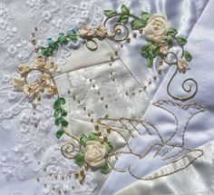 silk ribbon embroidery border patterns - Google Search  notice the gold beading, no emb. there. this must be very artfully couched gold trim.