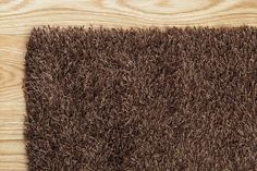 Brown Shag Rug on a Hardwood Floor