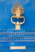 door knocker brass blue door