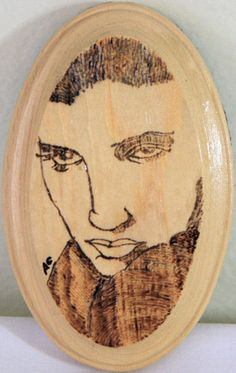 Elvis Presley Portrait Pyrography Woodburning Art.  Artist: Amber Grey.    Bless... don't give up your day job luv