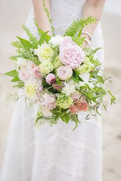 A pastel bouquet featuring peonies, dahlias, and ferns | Photo by Julie Dreelin | Floral design by Bells & Whistles