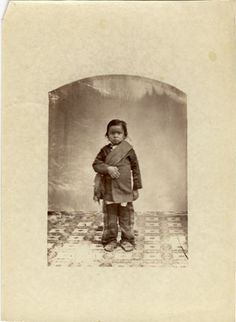 1877 photo of WINNEBAGO native american child.