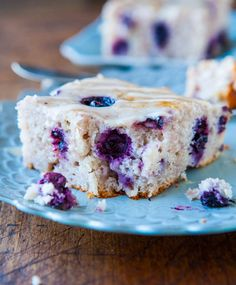 Blueberry Yogurt Cake with Lemon Vanilla Glaze... I used fresh berries which sunk to the bottom, but boy is this tasty!