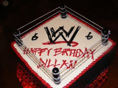 WWE cake: n this is what my jayden wants for his 7th birthday n he wants to put jon cena n the rock on the ring