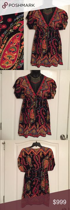 Floral Handkerchief Dress Pretty floral paisley deep v neck dress. Lots of vibrant colors. Cinched at waist. 100% rayon. NO TRADES. Angie Dresses Mini