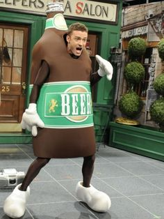 Okay, so he's not exactly drinking a beer -- but this is even better! Justin Timberlake dresses up as a dancing beer bottle during a Saturday Night Live skit on May 21, 2011.