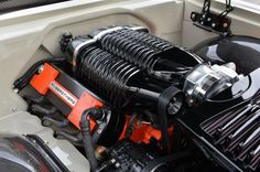 This is the Whipple-supercharged Wegner Motorsports LS7 engine of the 1966 Chevelle,built by the Ringbrothers, that outputs an astounding 980 horsepower. Special one-off fuel rail covers were precisely constructed for the Whipple supercharger to exactly match the design of the blower's case. A Holley Fuel Injection System with an Aeromotive fuel cell and pump keep the 91 Octane fuel feeding monster powerplant. Flowmaster mufflers enhance the roar of the engine and let this monster breathe.