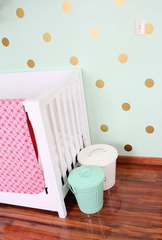 Nursery with mint walls and gold polka dots