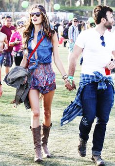 Alessandra Ambrosio wearing printed shorts and brown boots