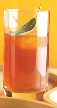 Shake up a batch of these mixologist-inspired cocktails, updated with a simple syrup of molasses and sage, and served over apple cider ice cubes for Thanksgiving!