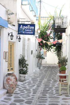 a little lane in Paros Island Greece, love the triangles tied together, or are they cloth napkins?