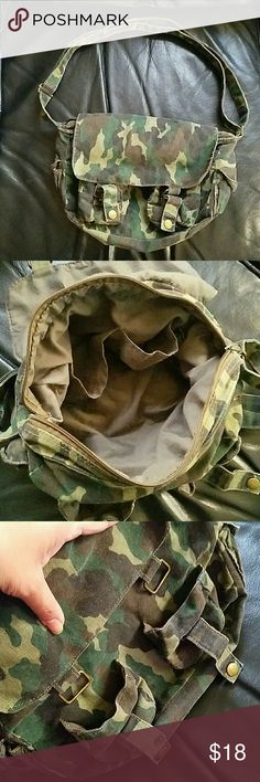"""Camo Canvas Bag Super cute! Good condition- don't want to get rid of, but need the $!   Zipper closure and flap that buttons closed.   Can be worn as a shoulder bag or crossbody.   2 inner pockets and 2 small velcro side pockets.   Approx 12"""" Long, 3"""" Wide, and 8"""" Height. Lapis Bags"""