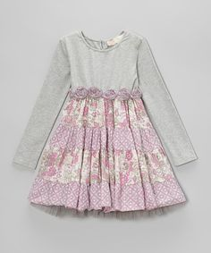 Tiers of vintage-inspired prints and tulle trim create an enchanting look on this comfy dress. Fit to be twirled, this fanciful frock is topped off with cozy long sleeves and a rosette waistband. Shell: 96% cotton / 4% spandexLining: 100% polyesterMachine washImported