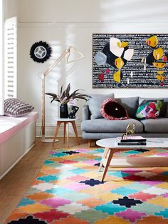 Contemporary Australian living room. Multicoloured rug, pink bench seat and oversized artwork are just some of the features that make this space pop. See more from this new collection by clicking on the photo above >