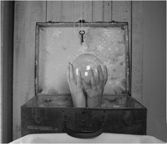 suitcase, hands, crystal ball.