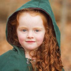 her red hair, rosy cheeks and green hood say it all.  #designer #kids #fashion