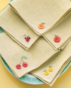 Fruity Button Embroidery Napkins It takes only a few stray buttons and some embroidery floss to transform plain napkins into a harvest of whimsical linens. This project appeared in Martha Stewart's Encyclopedia of Sewing and Fabric Crafts. Fabric Crafts, Sewing Crafts, Sewing Projects, Diy Projects, Project Ideas, Embroidery Stitches, Hand Embroidery, Simple Embroidery, Embroidery Floss Crafts