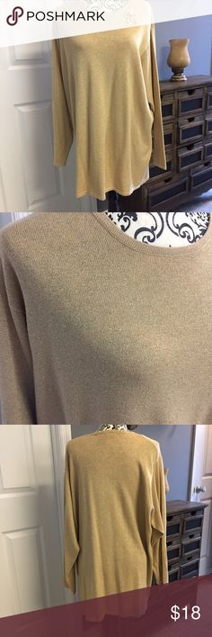 """Gold sparkle Lane Bryant sweater 18/20 Wonderful gold sparkle sweater by Lane Bryant. Sweater is gold with gold sparkle threading mixed in. 3/4 sleeve. Size says 18/20. Wonderful condition with no flaws noticed. Measurements laying flat are: 32 L x 25 W x 24"""" sleeve 🎀Suggested User 🎀 Lane Bryant Sweaters Crew & Scoop Necks"""