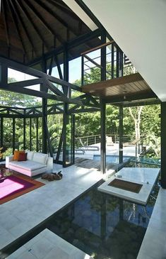 The Costa Rican jungle house, Quepos | Architect Juan Robles. Indoor reflection pool from collected rainwater.