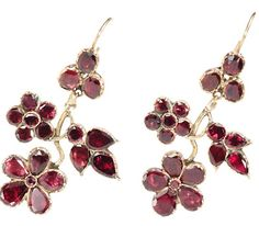 Georgian Almandine Garnet Earrings. Garnets were the darlings of daytime Georgian jewelry and when the gems were flat cut, they were perfect to be foiled and set closed back to enrich their natural coloration to a red, purple or pink hue….9k gold, modern 14k ear wires. Circa 1810