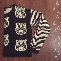 MINKPINK Tiger Sweater Love this! Great Condition! An eye catching tiger motif with matching stripe detail on sleeves! 100% acrylic   Need any other information? Measurements? Materials? Feel free to ask! Don't be shy, I always welcome reasonable offers! Fast shipping! Same or next day! Sorry, no trades!  Happy Poshing!☺️ MINKPINK Sweaters