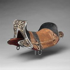 Ceremonial Saddle  Date: 17th–18th century Culture: Tibetan or Chinese Medium: Iron, wood, gold, silver, leather, silk, copper