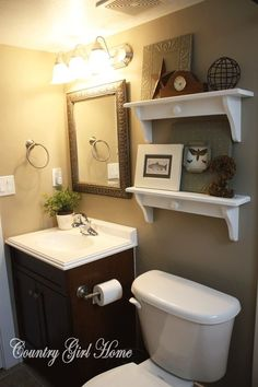 perfect for the smaller bathroom in the house. maybe visit granny and billys house for some of their old glass bottles for the shelves above the toilet?: