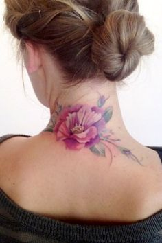 Colorful flower tattoo on the back of the neck, in soft pinks and purples.