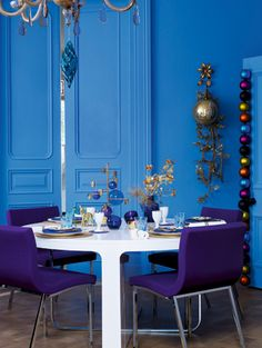 deep blue teamed with purple, and then the random xmas ornaments used almost as sculpture, so inspiring!