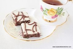 This easy-to-make unbaked Chocolate Coconut Square is sure to appeal to any sweet tooth and makes a fine addition to sweet trays Dessert Bars, Dessert Recipes, Desserts, Bistro Kitchen, Icing Ingredients, Chocolate Squares, Icing Recipe, Unsweetened Cocoa, Coconut