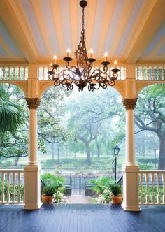 Front porch of Magnolia Hall in Savannah, GA, with a beautiful view of Forsyth Park.