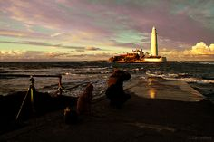 One man a camera a tripod a dog and a lighthouse by Graeme Darbyshire, via Flickr