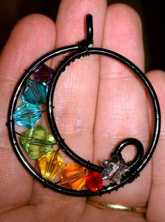 Metal: Colored Aluminum & Copper Wire Stones: Chakra Theme Swarovski Crystals Size: About 2 in x 1 inches Wire Necklace, Wire Wrapped Necklace, Wire Wrapped Pendant, Wire Jewelry, Beaded Jewelry, Handmade Jewelry, Jewlery, Jewelry Necklaces, Wire Pendant