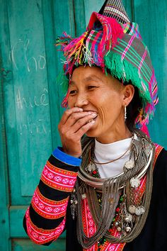 Vietnam   Portrait of a H'mong hill tribe woman wearing traditional clothing and headdress, located in Sin Ho market which is held every Sunday. Lai Chau   © Kimberley Coole