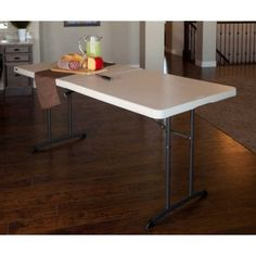 Lifetime Fold-in-Half Folding Tables 6-Foot 80264 Almond Color 12 Pack. This picture shows a table with food on it in the kitchen.